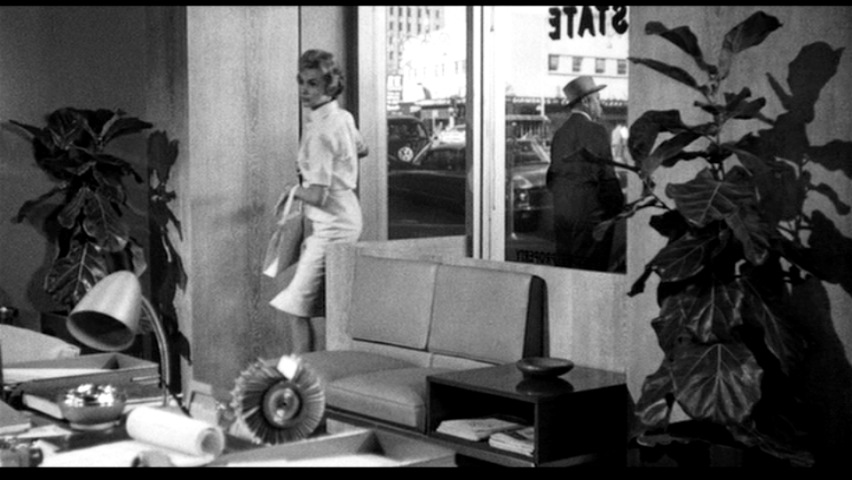 Still image of lady in an office form the 1960 film Psycho showing a long shot