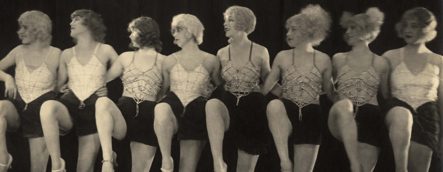 "Virginia Valli and the chorus line in ""The Pleasure Garden"""