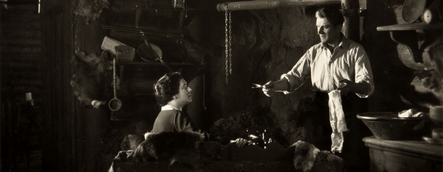 "Nita Naldi and Malcolm Keen in ""The Mountain Eagle"""