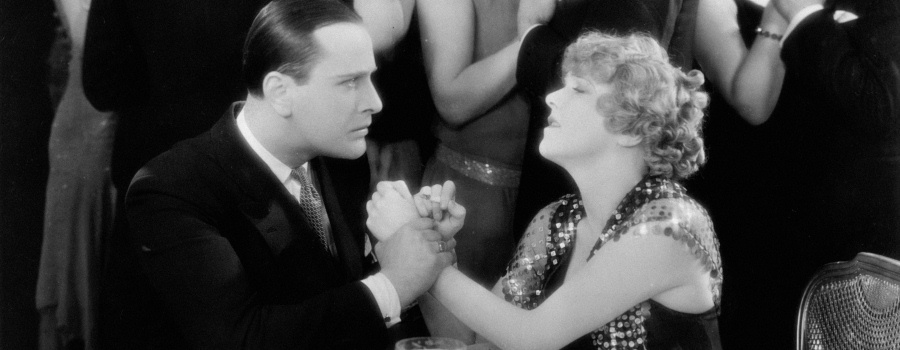 "Jean Bradin and Betty Balfour in ""Champagne"""