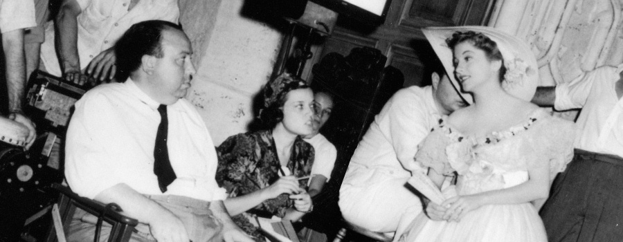 "Hitchcock and Joan Fontaine on the set of ""Rebecca"""