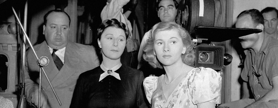 "Hitchcock, Judith Anderson and Joan Fontaine on the set of ""Rebecca"""