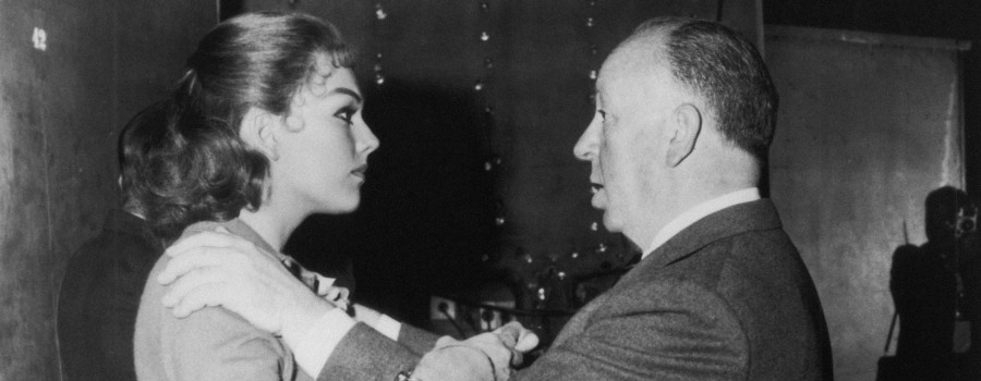 "Kim Novak and Alfred Hitchcock on the set of ""Vertigo"""
