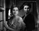 Rebecca (1940) - photograph - Photograph of Joan Fontaine and Judith Anderson in ''Rebecca''.