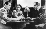 The Lady Vanishes (1938) - still - Publicity still of Michael Redgrave, Margaret Lockwood and Paul Lukas for ''The Lady Vanishes''.