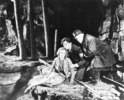 YOUNG AND INNOCENT (1937) - PHOTOGRAPH - Photograph from the mine sequence in ''Young and Innocent'' (Nova Pilbeam, Derrick De Marney, and Edward Rigby).