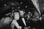 Rear Window (1954) - photograph - Photograph of Grace Kelly and James Stewart, taken duing the publicity tour for ''Rear Window''.
