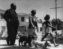 Alfred Hitchcock and family (1939) - Photograph of the Hitchcock family, walking their dogs (Edward IX and Mr Jenkins) in Los Angeles in 1939.