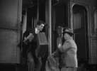 Film frame from ''Strangers on a Train'' (1951) showing Hitchcock's cameo appearance.