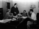 Photograph taken during a script conference for ''Lifeboat'' (1944). L-R: Kenneth Macgowan, Alfred Hitchcock, Alma Reville & Jo Swerling.